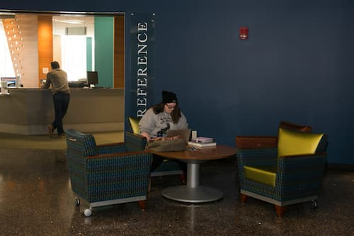 A student studying inside Buley