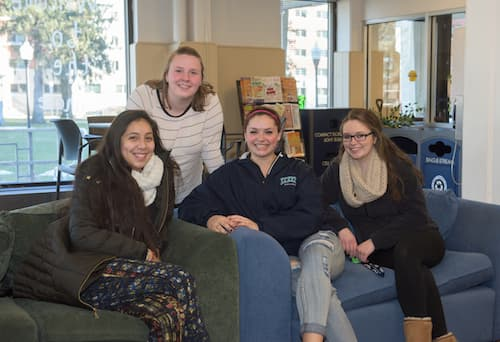 Students on couches in Chase dormitory common area