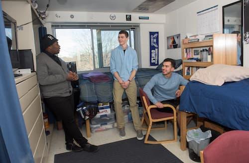 Three male students in Farnham dormitory room