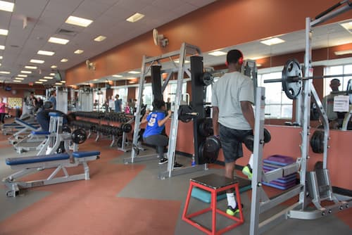 Students lifting weights in Fitness Center