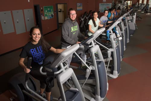 Students using stairclimber's in Fitness Center