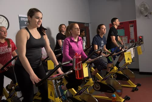Students using stationary exercise bicycles in Fitness Center