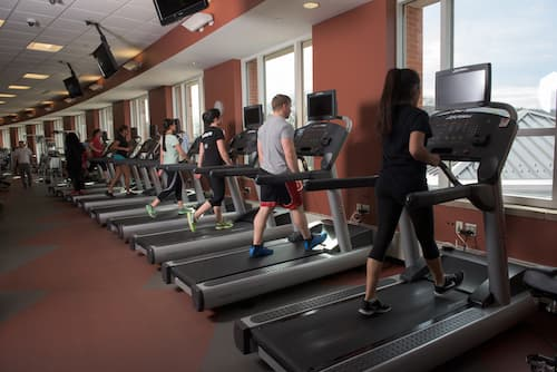 Students walking on treadmills in Fitness Center