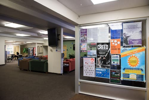 Posters on glass wall in Hickerson dormitory common area
