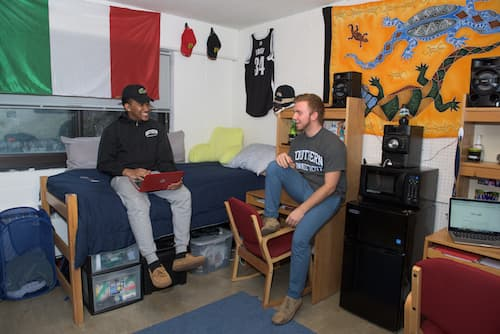 Two students in Hickerson dormitory room