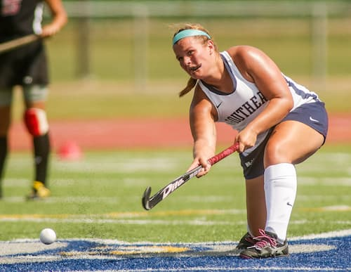 Field Hockey athlete with ball