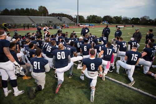 Football team kneeling