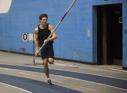 A student running with a pole