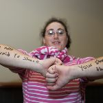 Student with words written on arms