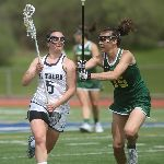 Two female lacrosse players, one in white and one in green uniforms