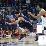 SCSU athlete running with basketball