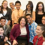 Sonia Sotomayor with 11 children smiling
