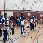 Marching band practicing in a gym