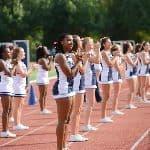 two rows of cheerleaders cheering