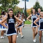 cheerleaders walking in a parade