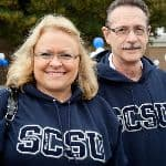 a man and a woman both wearing an SCSU shirt