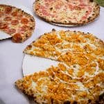 three pizzas on a table