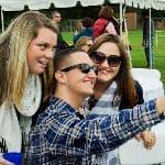 Students posing at Homecoming