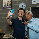 Jay Leno posing with student for selfie