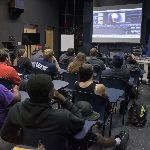 Students observing a presentation