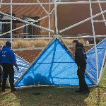 Students and faculty constructing an icosahedron