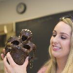 Student observing a human skull