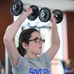 Student lifting weights