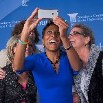 Robin Roberts taking a selfie with 3 people