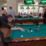 A student playing pool
