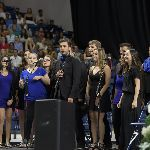 A group of singers singing during commencement on stage
