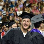 Student smiling during commencement