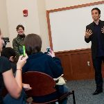 Apolo Ohno speaking in a class
