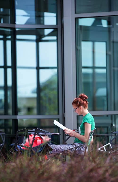 Student studying in front of the new Science Building