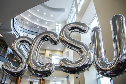 Silver balloons with letters SCSU