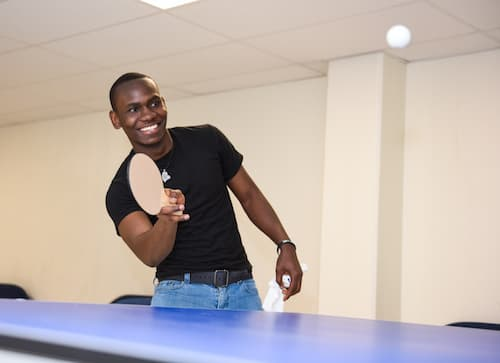 Student playing ping pong