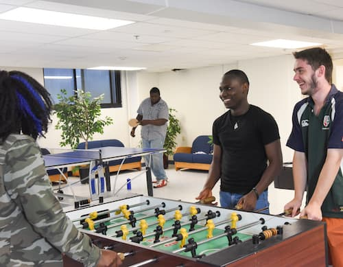 Students playing foosball inside Wilkinson Hall